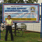 Nadine France in front of the TASO sign