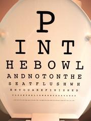 P I N T H E B O W L (toilet seat cover at my Opthalmologist's)