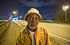 Angels Are Messengers From God (Thomas Hawk) Tags: street usa man hat yellow night oregon portland delete2 fav50 10 unitedstatesofamerica save3 save7 save8 delete save save2 fav20 save9 save4 save5 superfantastique save10 save6 fav30 burnsidebridge savedbythedeletemeuncensoredgroup fav10 fav25 fav100 fav200 fav300 fav40 fav60 fav90 fav80 fav70 superfave twippeople