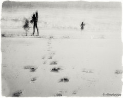 Exploring... (vilmaca) Tags: icm painterly sand pacificocean people kids nature beach sunset playing