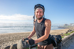 Touring Cyclist with Bicycle by Beach (JFJacobszPhotography) Tags: overland elements bicycle discover long young weight gear explore ready packspanniers hybrid beach road supplies journey intrepid experience far stamina go single white sidewalk twenties loaded bags tent back travel time alive sunrise one weather side sea earlymorning ride man adventure ocean distance open packed overlanding cloudy front luggage early frame life gearedup