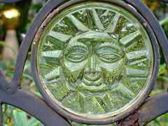 Rising in the East (jen c07) Tags: sun art glass face circle sunglass glasswork gardengate rustydoor smilingsun dlis571fa07