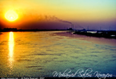 Polluting the River Nile and its Beauty [HDR] (KoRaYeM) Tags: road sunset sun nature digital photoshop work canon river landscape geotagged 350d rebel xt factory smoke egypt ring nile cairo pollution digitalrebelxt giza hdr hdri lightroom waterscape photogallery pollute gizah blueribbonwinner  photomatix supershot jiza jizah  6xp     colourartaward artlegacy theperfectphotographer korayem  geo:lat=30133835 geo:lon=31203773