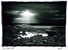 porthcawl seascape (Dan_wood) Tags: sea bw beach wales landscape rocks sunbeam sunray porthcawl sker