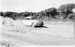 My VW driving across the Nullarbor bulldust after leaving Madura. (spelio) Tags: suss beetle dirtroad bulldust 1965 link www outback australia 64views nullarbor vw scan dust dirt unsealed 145views090512 clm174 favs favourites favorites linked remote bumps track road fave vwaustralia vw1965beetle vwbeetle1965