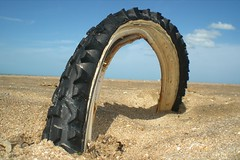 Tyre. (DJ Bass) Tags: uk blue sky abandoned beach catchycolors cycling kent sand surreal bikes bluesky odd coastal grip twisted tyre wembleystadium djbass danbass