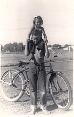 my mom and her brother, early 1950s (deflam) Tags: boy arizona phoenix girl bike bicycle vintage mom uncle jeans bow 1950s kathy carroll gilmer