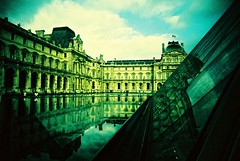 Dark Reflections... (Trapac) Tags: autumn paris france film water museum buildings reflections xpro crossprocessed fuji pyramid slidefilm plasticfantastic velvia vivi vivitar pei plasticcamera impei 50iso thelouvre fujivelvia wmh vivitarultrawideslim vivitarultrawideandslim lalouvredemuse vivitarws vivitarroll1