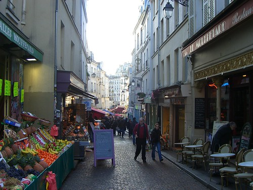 Shoppers throng Rue Mouffetard in Paris even in winter.