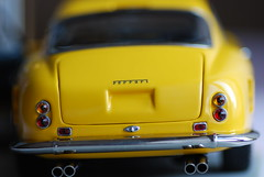 Chasing Berlinetta 250 passo corto (leasingmarket) Tags: yellow metal miniature model pipes ferrari mascot replica end luxury exhaust rearend granturismo diecast chromed shortwheelbase passocorto cmcmodel leasingmarketro truetotheoriginal