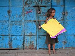 Yellow Patang (Meanest Indian) Tags: people india kite children forsakenpeople gujarat ahmedabad uttarayan patang