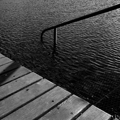 Bad Tiefenbrunnen (So gesehen.) Tags: wood winter shadow bw sun lake water square schweiz switzerland see zurich bad cropped railing grdigital tiefenbrunnen