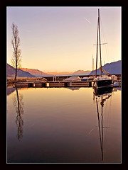 Peaceful sunset over the lake (Megara Liancourt) Tags: mountain lake france savoie sonyalpha100 diamondclassphotographer flickrdiamond platinumheartaward betterthangood theperfectphotographer poseidonsdance
