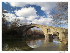 Ziakas (kzappaster) Tags: bridge sky reflection architecture clouds river four olympus greece zuiko soe breathtaking 43 thirds stonebridge e500 zd blueribbonwinner 1122mm grevena 10faves mywinners abigfave anawesomeshot venetikosriver superbmasterpiece diamondclassphotographer ziakas amazingamateur theunforgettablepictures photofaceoffwinner betterthangood