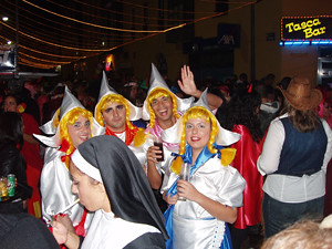 Where fancy dress is the norm - is that a real nun having a sly puff?
