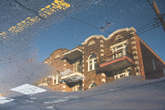 The Plateau melt (Jonathan!) Tags: winter red snow canada cold reflection building home architecture spring melting seasons apartment flat quebec plateau montreal 4d residentialbuilding fourthdimension gettyimagescanada