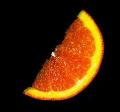 slice (Hazy Days) Tags: orange fruit juicy sweet slice segment citrus vitaminc goodforyou tangy abigfave nikond40 theunforgettablepictures manual55mmlens