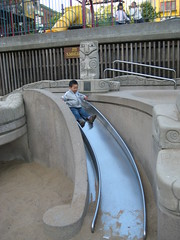 Sliding down the slide in Portsmouth Square