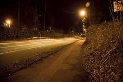 The cold outside my house (jamesgrayking) Tags: road street light orange car night dark james king pavement gray trails sidewalk hedge