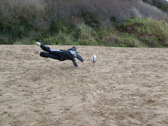 Touch down (dandavie) Tags: playing beach fun rugby dive