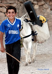 Renting a pack-animal for carrying guitar & ... (Dr. Hendi) Tags: boy portrait people mountain me smile face animal animals kids work myself children monkey persian kid day village iran guitar transport domestic rent    bakhtiari     siamak     baghmalek    anoosh shahmongasht    doctorhendii