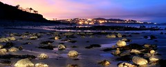 Luminous Rocks (Dave G Kelly) Tags: longexposure nightphotography pink blue ireland light sunset pordosol sea sky autostitch howth dublin costa mer lightpainting reflection beach water gua night clouds canon dark landscape 350d lights evening coast mar twilight rocks eau meer wasser europa europe tramonto mare nocturnal dusk shoreline torch shore flashlight coastline bluehour canoneos350d luminous dalkey dublino irlanda irlande kste exposio puestadelsol coucherdusoleil killiney thebluehour shankill langebelichtung littoral exposicinlarga exposiolonga irlandia kstenlinie 1855lens 10faves ctedeaudemer davegkelly