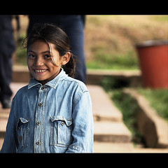 Bluefields Girl (gunnisal) Tags: world street portrait people colors girl smile child faces young nicaragua bluefields olympuse500 iloveyoursmile abigfave goldstaraward