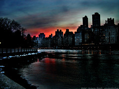 roosevelt island sunset (atomicshark) Tags: nyc newyorkcity sunset newyork ice water colors night clouds reflections dark island evening nikon dusk manhattan roosevelt coolpix nikkor gotham 4500 blueribbonwinner atomicshark anawesomeshot aplusphoto fiveflickrfavs