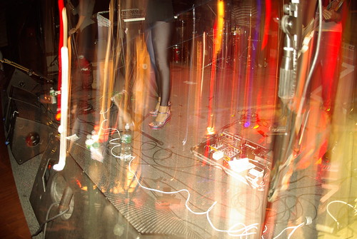 Pedals, feet, and blurry lights