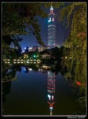Taipei101 in mirror (AIDS & Red ribbon) (Sherwin_andante) Tags: taipei taipei101 2007 國父紀念館 e510 blueribbonwinner 10faves explored mywinners 200712 fiveflickrfavs 20071112 20071112choice