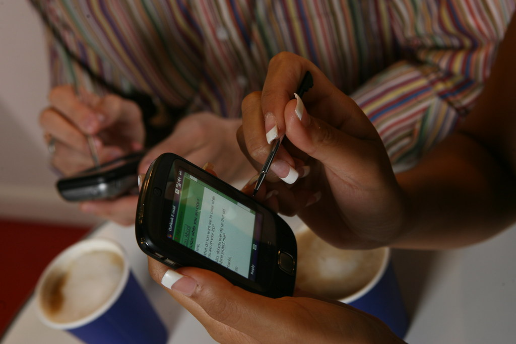 Woman using Outlook Mobile with coffee by gailjadehamilton, on Flickr