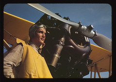 Marine lieutenant by the power plane which tows the training gliders at Page Field, Parris, Island, S.C.  (LOC) (The Library of Congress) Tags: usmc airplane aircraft aviation goggles engine ww2 marines libraryofcongress 1942 canary boeing propeller promise marinecorps pilot naf stearman unitedstatesmarinecorps usmarines yellowper