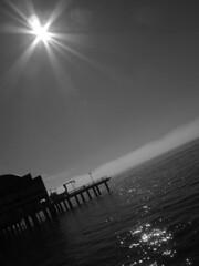 B&W Sun (Trion) Tags: seattle sea sun mist reflection blancoynegro sol water muelle mar blackwhite dock agua reflejo