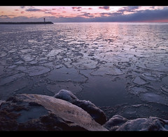 Iced (robert_goulet) Tags: sky lighthouse lake ontario canada ice clouds sunrise pier frozen rocks purple zoom harbour patterns magenta floating olympus lakeside mauve lakeontario hue zuiko cracked oakville bronte daybreak evolt e500 zd fourthirds 1454mm mikecrough