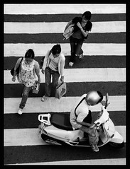 Crosswalk (It's Stefan) Tags: girls boy people blackandwhite bw white black lines composition contrast shopping walking roc blackwhite asia asien downtown traffic angle gente geometry stripes  helmet taiwan scooter aerial roller sw taipei asie bags minimalism formosa crossroad crosswalk  verkehr zebrastreifen ilha birdseyeview plonge zebracrossing kreuzung lineas streifen vogelperspektive birdeye ilhaformosa onestep  linien  pasocebra   madeintaiwan  vistadepjaro  republicofchinataiwan  abigfave escter perspectivevoldoiseau enplonge asien  stefanhoechst stefanhchst stefanhoechst