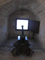 point the cannons against  the hunger in the World (free-secret-life) Tags: autumn tower portugal window river lisboa cannon tejo belm searchandreward freesecretlife