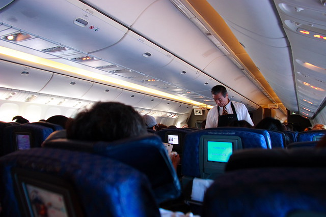 Flight Attendant and Interior of American Airlines Boeing 777