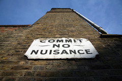 Commit No Nuisance Sign London (greenwood100) Tags: old uk blue england sky building brick london sign wall thames warning vintage peeling order britain decay pipe perspective explore crime gutter southwark decayed se1 discipline londonstock welcomeuk