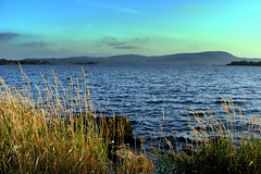 Mountshannon (Vanessa Kennedy) Tags: blue ireland sky lake water grass clouds clare lough hills mountshannon
