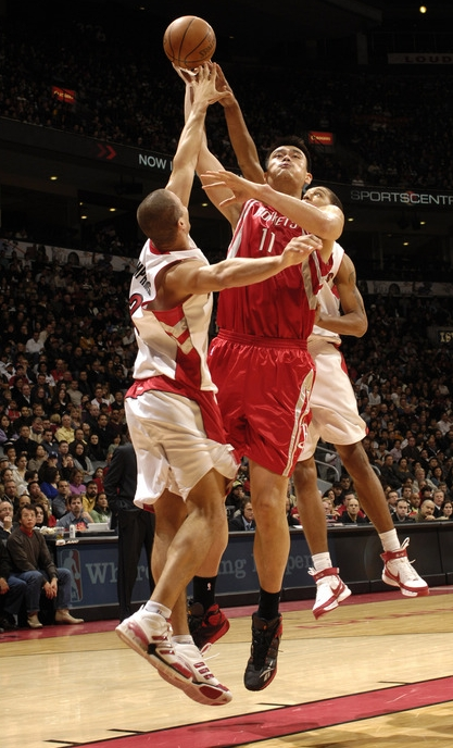 Yao Ming shoots a hook shot over Toronto's Kris Humphries.  The Rockets played poorly in the second half, with Yao taking only 10 shots (while McGrady shot 21) and scoring 15 points.