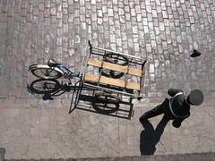 bird's eye view (sonyacita) Tags: man peru bike bicycle uniform pigeon cusco cobblestone lookingdown cart