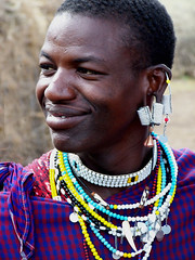 Maasai Warrior (geoftheref) Tags: africa park travel portrait people smile photoshop de tanzania person la interestingness interesting flickr tribal safari ngorongoro national crater warrior afrika tribe serengeti masai maasai masaai  frica tanzanie lafrique tanznia  geoftheref dellafrica   afrikasafari
