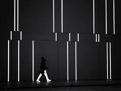 the barcode (Sandy...J) Tags: olympus lines walking man monochrom blackwhite streetphotography urban wall architecture white black