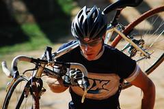 Man going up the Hill (Melifiscentgirl) Tags: california man black sunglasses bike cycling bokeh helmet dirt fox cyclocross bicycleracing californiacycleracing bikecarry
