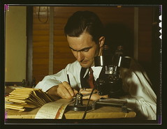 Geologist examining cuttings from wildcat well...