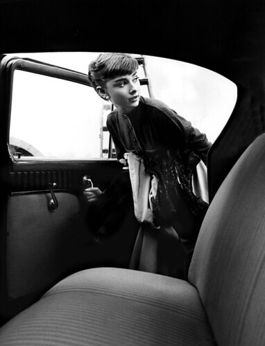 Audrey Hepburn getting into Studio car, 1953.