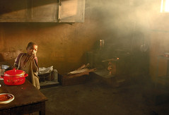 The Cook (JakeBrewer) Tags: poverty africa light red kitchen bravo villages pots congo woodstove drc 2007 eastafrica littlestories 25faves fivestarsgallery abigfave picswithsoul