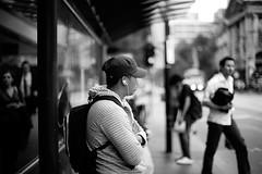 IPOD MAN (*Cyrus`*) Tags: man blur dof bokeh melbourne busstop canoneos5d abigfave aplusphoto ef50mmf12l auselite
