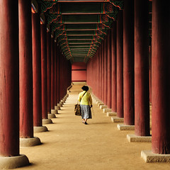 Walking Away (christian.senger) Tags: travel red people digital geotagged nikon asia pillar korea symmetry explore seoul column gyeongbokgung d300 nikoncapturenx2 christian_senger:year=2009