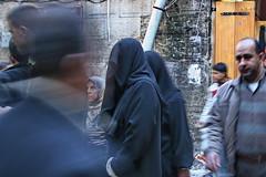 Gazing... (hazy jenius) Tags: world trip travel girls people woman shop shopping store veil market headscarf middleeast hijab backpack cannon modesty syria bazaar niqab souq oldcity aleppo globalphotojournalism haleb hejab